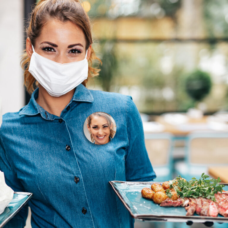 Face Photo Button on a Waitress Wearing a Mask